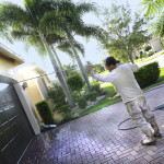 Series:Hispanic Male painter power washing an upscale home