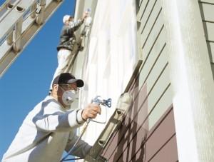 Man spraying wall