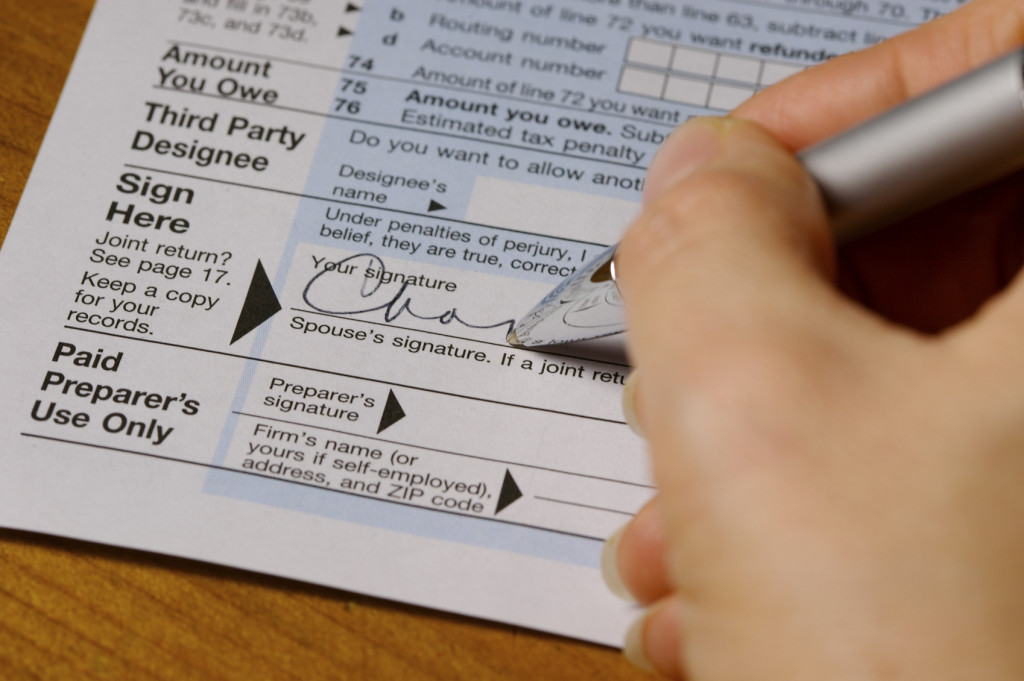 Signing Blue Tax Form